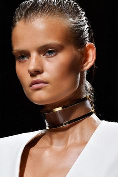 The necklace now is all about the tight embrace, with chokers taking chic hold in heavy metals, gems and beyond. Pictured: Balmain