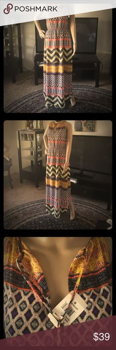 Ladies size M full length maxi by Sanctuary NWT This cute Summer Maxi is by Sanctuary. Amazing colors and shades of purple royal blue coral yellow black cream white. This particular dress was so popular that it was sold out at Nordstrom's and Nordstrom's rack. This is a size medium. Notice the Close your time as you can cinch it up for a different look or leave it loose to hang open or somewhere in between. This item is new with tags Sanctuary Dresses Maxi