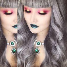 Christmas-y... I think. Sparkly present eyes and Christmas tree lips ? No? Okay... Maybe not. I tried lol. Here are the product details.  Necklace: @fantasyaccessorybox (code naye0na). Lips: @nyxcosmetics wicked lippie in risqué. Eyeshadows: @morphebrushes (code ADOPTLOVE). Foundation: @kohgendo 113. Glitter: @shopvioletvoss. Lashes: @lashesbylena in Claudia (code naye0na). Hair: @hairhegoes custom wig.