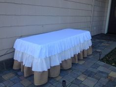 Burlap Ruffle Tablecloth -- could use layered bed skirts