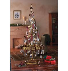 """Holiday Ornament Tree $179    Product Description    Your dazzling seasonal arrangement will truly light up any room. Our metal tree has a """"vintage"""" gold finish, with room to display up to 90 of your prized ornaments. Sorry, no Air Express. Tree is 40""""h x 16""""d.    Antique-Gold Ornaments  Highlight two charming memories in two distinct forms — goldtone rectangles or goldtone ovals. Rectangle set has burgundy satin ribbons for hanging, accented with cranberry-colored beads. Oval set ..."""