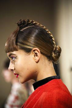 Bun, scalp braid and a low bun at Tata Naka. Hair by Cos Sakkas and the TONI&GUY Session Team #LFW #AW15