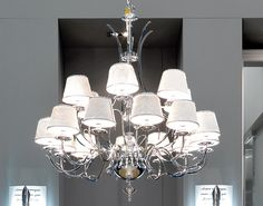 Structure with 18 arms in chromed brass. Truncated lampshades in silk or covered…