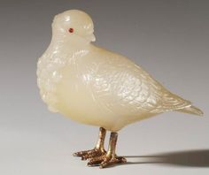 Pigeon Fabergé  Both King Edward VII and the Prince of Wales (later King George V) kept homing pigeons at Sandringham next to Queen Alexandra's dove-house. According to contemporary accounts, most of the pigeons were of famous Belgian breeds. This one is of carved chalcedony with ruby eyes. Text adapted from Fabergé's Animals: A Royal Farm in Miniature   Provenance  Commissioned by King Edward VII, 1907 (the Sandringham Commission)