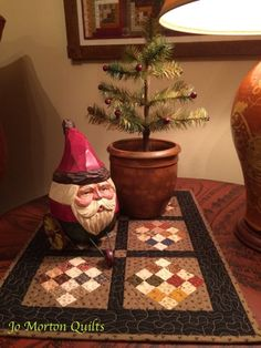 Last but not least - Watson quilt looks good with Rolly Poly Santa on wheels and feather tree in antique redware pot.