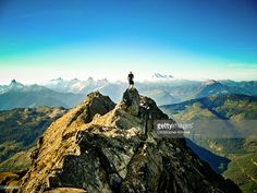 A hiker stands on the summit of Lady Peak in Chilliwack, British Columbia, Canada.