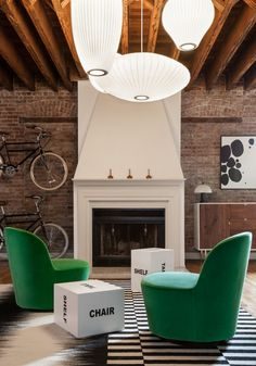 Interior Design by Fanny Abbes of The New Design Project | Photography by Alan Gastelum | Modern Sanctuary | A Chic Urban Loft in Jersey City | Living Room | Lighting| Modern Living Room | Loft | Seating | Fireplace