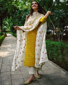 Shop online Dandelion Ikat Printed Suit Set - Set of Three Dandelion yellow ikat printed cotton kurta, teamed with a beautifully embroidered mul dupatta and embroidered cotton pants makes for a flawless ethnic outfit. Casual Indian Fashion, Fashion In, Indian Fashion Dresses, Dress Indian Style, Indian Designer Outfits, Designer Dresses, Indian Dresses For Women, Indian Fashion Designers, Designer Wear
