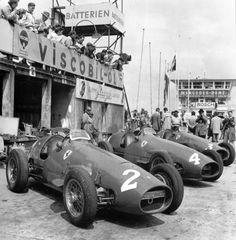 Ferraris of Giuseppe Farina (#2), Luigi Villoresi (#4) and Mike Hawthorn (#3) lined up at their pits during the 1953 German Grand Prix at Nürburgring