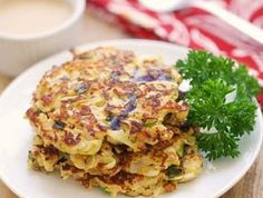 Cabbage Pancakes with Spicy Dipping. Cabbage Pancakes with Spicy Dipping Sauce Keto Cabbage Recipe, Cabbage Recipes, Beef Recipes, Real Food Recipes, Vegetarian Recipes, Cooking Recipes, Low Carb Zucchini Recipes, Low Carb Veggies, Vegetable Recipes