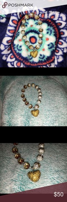 💎sale!💎 Ombré gemstone heart bracelet Brand new, hand - crafted bracelet with an ombré pattern & gemstone - paved design. Colors are amber, white, gold & brown. It has an elastic band, so there is no clasp. Beautiful & durable bracelet that can go with practically any possible outfit! Offers are welcome 🙂🙂 Jewelry Bracelets