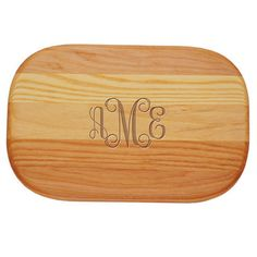 """This wood board is the perfect choice for those smaller cutting and chopping tasks. Perfect size of a cheeseboard and small veggie board. Made of a combination of Yellow Birch and New England Ash to give a subtle combination of color and grain pattern. Board measures 10"""" x 7"""" x 3/4"""" with rounded corners. Each board is sealed and hand rubbed with our proprietary finish. Monogram style and positioning only as shown."""