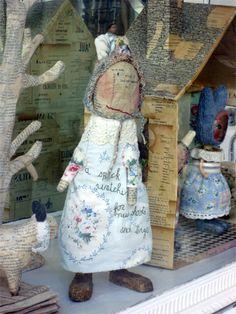 Sweet folk art by Julie Arkell.  Paper mache' dolls, trees, house, etc.  London.