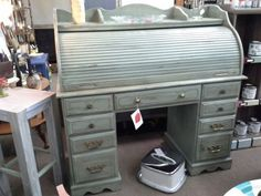 "$160 - This roll top desk has seven drawers in the base and cubbies behind the roll top.  It has a custom paint and dark glaze. The top has been finished with ""tuff top"". The desk measures 50 inches across the front and 22 inches deep. It stands 48 inches to the tallest point.  It can be seen in booth C 19 at Main Street Antique Mall 7260 East Main St ( E of Power Rd ) Mesa 85207  480 9241122open 7 days 10 till 530 Cash or charge 30 day layaway also available"