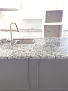 White cabinets with gray painted island, level 4 granite