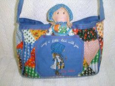 holly hobbie purse with doll - Yep I had this when I was little. Loved it... must have ended up in the yard sale at some point!
