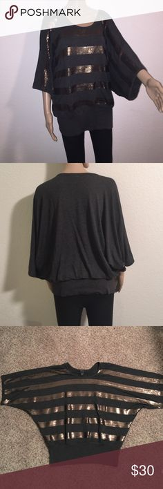Dolman sleeve round neck top Dark grey dolman sleeve round neck top with fitted waist. It is made of stretchy material with horizontal flat sequin detailing on front. This could be worn off one shoulder for the new in-style look. Karen Kane Tops Blouses