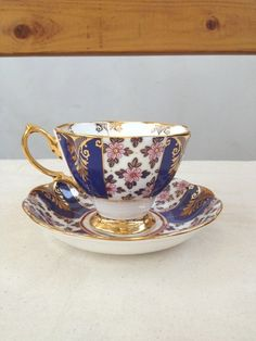 Royal blue purple, Gold, floral pattern, 1930's Vintage Teacup and saucer with color block stripes, Royal Bone China