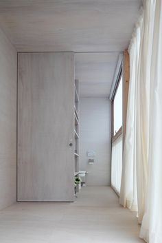 Japanese wooden house by Atelier Sano #closet #bedroom #simple #sliding #door #windows #curtains