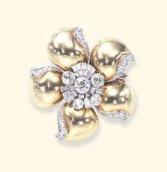 DIAMOND AND GOLD FLOWER BROOCH, BY SUZANNE BELPERRON, circa 1935. Designed as a flowerhead, centering upon an old European, baguette and square-cut diamond cluster pistil, extending articulated polished gold bombé petals, each trimmed by single and old European-cut diamonds, mounted in platinum and 18k gold, with French assay marks.