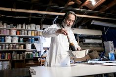 Tanahashi prepares one of his calligraphy brushes in his Berkeley studio.