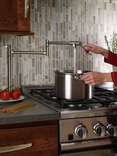 This image was originally shared to highlight the convenience of the pot filler, but we happen to love that vertical cascading tile. #backsplash #kitchen
