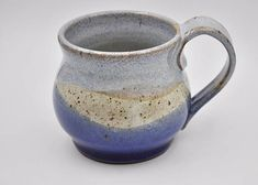 Ceramic Mug, Pottery Mug, Handmade Mug, 14 oz Mug Hand thrown mug made from stoneware clay and topped with lead free glazes in colors reminiscent of speckled sand, frothy foam and depths of the blue sea. This ceramic mug holds approximately 1 3/4 cups when full to the brim, stands a
