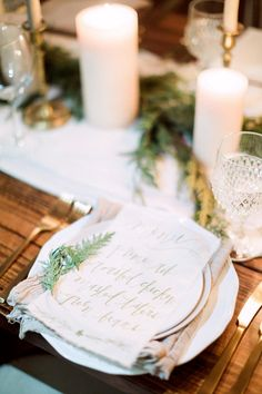 Holiday table. Calligraphed menu card.  Photography : Hunter Ryan Photo Read More on SMP: http://www.stylemepretty.com/living/2016/12/09/a-cozy-candlelit-holiday-gathering/