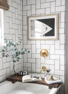 I love the way the white metro tiles have been designed in this bathroom. The brass bathroom fittings and eucalyptus really soften the space.