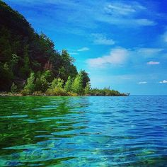 Rolling hills, beautiful foliage and crystal-clear waters are just some of what you'll find during a summer in @TraverseCityTourism! Thanks to Instagrammer @squirrelman2340 for sharing this beautiful shot from TC. #PureMichigan #TraverseCity