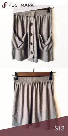 Grey Pocket Skirt Very flowy and comfortable. Perfect for these upcoming late summer nights! The waistband also stretches. Poof! Skirts Mini