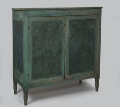 Shenandoah valley painted pie safe with intricate punched-tin panels and turned legs.