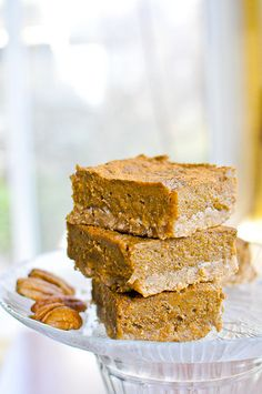 Oatmeal Pumpkin Bars  2 c oats  1 c pecans, 1 c. flour  3/4 c. agave nectar   1/2 c canola oil   2 t vanilla  1 t salt  2-15 oz cans pumpkin   1/2 c almond milk.   2/3 c agave nectar  2 t vanilla extract  1T cinnamon  1 tsp ground ginger  1 tsp ground nutmeg  1 tsp salt  1/4 heaping cup of arrowroot  These were super.  Subbed more flour and half as many cashews as pecans and they were yummy!  I used unprocessed sugar rather than agave in the filling only. (About 1 c. maybe less)