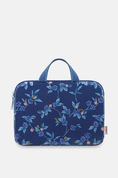 """Stow your laptop in this protective printed sleeve. It has a soft, cushioning lining and a wipe clean oilcloth exterior, and will hold a 13"""" laptop. The sturdy webbing handles make it extra portable and the fastening has an easy double zip. Cath Kidston Laptop Sleeve, Oilcloth, Midnight Blue, Laptop Sleeves, Cleaning Wipes, I Am Awesome, Handle, Exterior, Zip"""