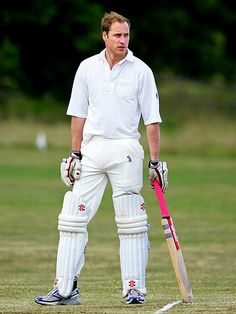 BAT MAN  At the ready! William swaps his military uniform for that of a cricketer, playing in a friendly game on behalf of the King's Head Inn on July 17, 2010, in Chipping Norton, England