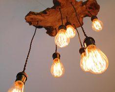 Modern Live-Edge Olive wood Light Fixture with 3 lights. Rustic Industrial Chandelier Modern Live-Ed Farmhouse Chandelier Lighting, Rustic Bathroom Lighting, Rustic Light Fixtures, Industrial Chandelier, Wood Chandelier, Rustic Lighting, Chandeliers, Lighting Ideas, Rustic Loft