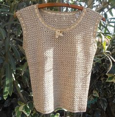 #Vintage gold knit #top in handmade. Hand knitted. Gold ribbon and bow trimmed. Sleeveless. Good condition. Size :  small Tall…