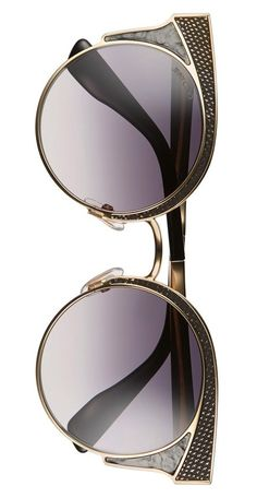 Obsessing over these eye-catching sunnies in rose gold and black.