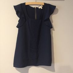 Beautiful navy blouse Gorgeous ruffle sleeved blouse with zipper in the  back Maison Jules Tops Blouses