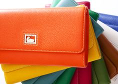 SUCH A CLUTCH! Our Dillen Clutch has it all. It¹s large enough to carry day or night, it has a handy detachable shoulder strap and it comes in fourteen amazing colors, from rainbow brights to go-with-anything neutrals.    Dillen II Clutch, 6L325, in Tangerine, Sunflower, Sea Foam, Green, Strawberry, Grass, Desert, White and Ocean Blue.