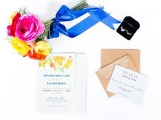 Modern wedding invitation idea - white invitation cards with watercolor floral motif and blue text {WebLens Designs Photography}