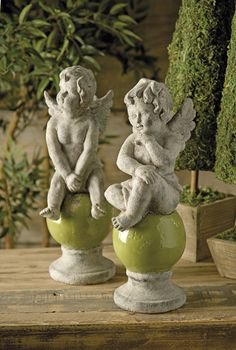 Esteri Angel Statuaries - Chubby cherub angels perch on green orbs in the Esteri Angel Statuary. An angelic touch to your garden room or foyer.