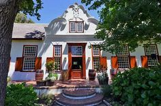 Interesting places to visit in South Africa. Stellenbosch is a university town in South Africa's Western Cape province. It's surrounded by the vineyards of the Cape Winelands and the mountainous nature reserves of Jonkershoek and Simonsberg. The town's oak-shaded streets are lined with cafes, boutiques and art galleries. Cape Dutch architecture gives a sense of South Africa's Dutch colonial history.... #wine #southafrica #wineestate #tourism #extremefrontiers #wineroute #adventure #holiday… Colonial Architecture, Interior Architecture, Interior Design, Cape Dutch, Dutch House, Dutch Colonial, Out Of Africa, South Africa, Holland
