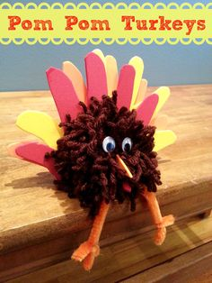 Easy Thanksgiving craft for kids: Pom Pom Turkey!   Perfect to use as a Thanksgiving Centerpiece, personalized with the hand prints of the child. #shop #cbias