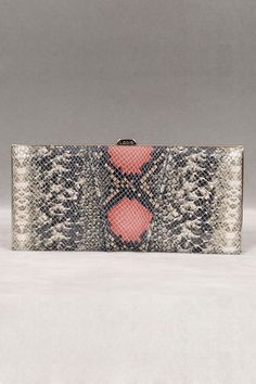 I lovelovelove this snakeskin clutch. The pink is perfect with it!