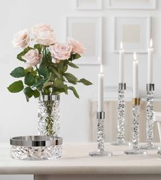 Remember to stop and smell the roses! Loving these beautiful Carat Candlesticks by @Orrefors #EntertainBeautifully