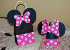 Minnie Mouse from black posterboard, pink posterboard and white circle stickers