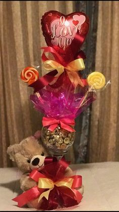 Learn how to make romantic Valentines gifts for your husband that he'll absolutely love - candy bouquets! You can buy all the supplies you need at your local dollar store for these awesome presents… Valentines Day Baskets, Valentines Day Gifts For Friends, Valentines Day Decorations, Valentine Crafts, Candy Bouquet Diy, Valentine Bouquet, Cadeau St Valentin, Valentine's Day Gift Baskets, Raffle Baskets