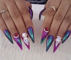 Jewel toned crystal holographic chrome long sharp stiletto nails