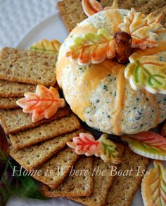 Mix cream cheese and chives with a Monterey Jack & Cheddar cheese blend. A pretzel rod provides the stem and Cheddar cheese~ the ribs. Egg wash tinted with food coloring is painted on cookie cutter pie crust leaves for a decorative touch.